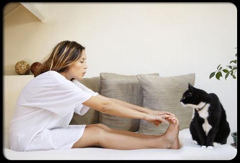 27 ways pets can improve your health s19 woman stretching 27 Ways Pets Can Improve Your Health