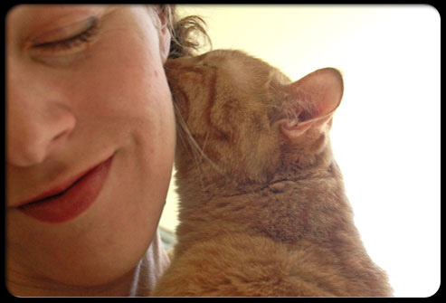 27 ways pets can improve your health s2 cat licks womans ear 27 Ways Pets Can Improve Your Health