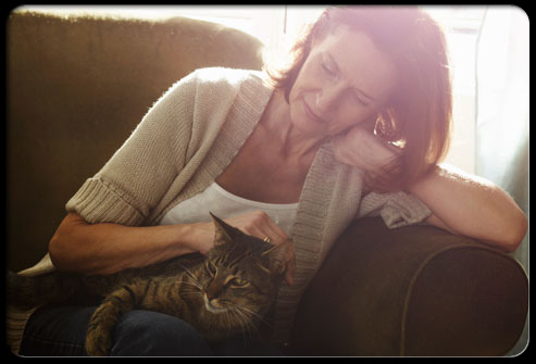 27 ways pets can improve your health s6 woman petting cat 27 Ways Pets Can Improve Your Health